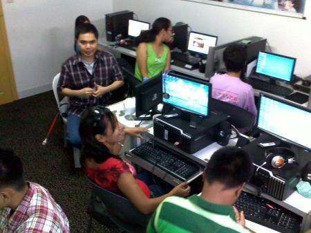 ATRIEV's training participants and Julius, discussing web accessibility
