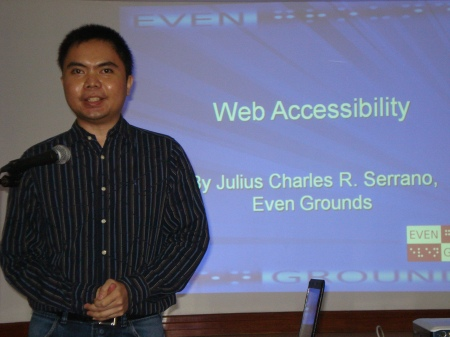 Julius talking to the audience during the Information for All seminar