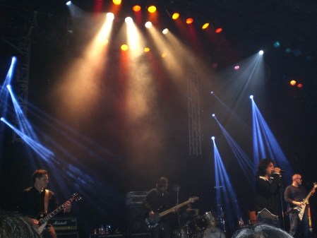 Razorback performing on stage during Three Minutes of Glory album launch